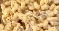 Per reviewers, halve the salt. Expensive to make, but worth it. Mac and Cheese recipe from Ina Garten via Food Network.