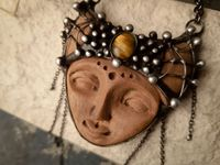 Ceramic head pendant- A cozy keeper of clay and sand. Clay mask necklace with Tiger eye natural stone. $49.00