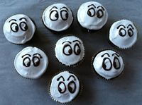 Google Image Result for http://live.gourmet.com/wp-content/uploads/2011/10/Ghost-Cupcakes-1024x764.jpg