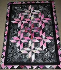 Half Square Triangle Quilt with Borders