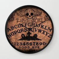 https://society6.com/product/sugar-skull-ouija-board wall-clock?sku=s6-7117488p33a33v284a34v286#