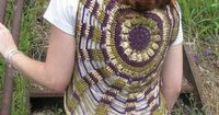 I am working on this vest right now. I opted for the more economical Super Saver yarn. It looks like you can make this entire yarn with 1 skein of the solid color or 2 skeins of the variegated.