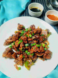 Chicken manchurian is a popular Indo Chinese snacks recipe where crisp fried chicken are stir fried with a manchurian based sauce.