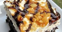 Snickers Cake 1 box devils food cake mix, plus ingredients to make the cake 1 can sweetened condensed milk 1 jar Smucker's hot caramel ice cream topping 1/2 cup chocolate chips 2 cups heavy whipping cream 1/2 cup powdered sugar 1 tsp vanilla 3 snicker...