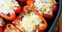 Santa Fe inspired stuffed bell peppers loaded with a zesty filling of ground turkey, corn, black beans, hot peppers and tomatoes, topped with melted cheese and