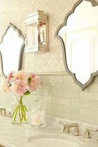 tile *** THIS is ABSOLUTELY BEAUTIFUL! Adore the tile work, and the lovely shaped mirrors help show it off, they're not oversized, you get to see the beautiful tile and workmanship. The soft colors chosen , lantern light fixture in between - likely ot...