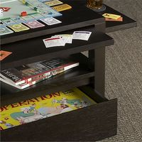 """Clever design by Blake Tovin amps up the traditional coffee table with gathering-friendly built-ins. Three pull-out shelves'�'�""""two side and one center'�'�""""extend to hold drinks, poker chips and game accessories. While undern..."""