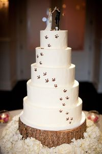 LOVE this Pawprint Covered Wedding Cake with the adorable Dog Figurine on the top with the bride and groom (see http://www.weddingfavorsunlimited.com/miniature dog figurine cake toppers 5 designs.html and http://www.weddingfavorsunlimited.com/high fiv...