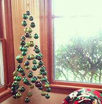 A Christmas Tree Made Of Suspended Ornaments