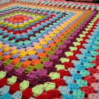 Square crochet blanket. We should really learn to crochet cha! Look how awesome that looks. Now picture it hanging over your couch. I know.