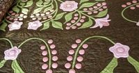 So many traditional applique quilts are done on white or ivory. How's this for a contemporary take on applique?
