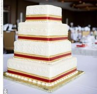 Cake idea - we're having square, 3 tiers, smooth white buttercream. I like the red and gold at the bottom of each tier.