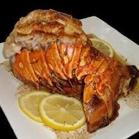 Broiled Lobster Tails | See how to prepare delicious broiled lobster tails. The recipe is so simple, and yet it's very impressive. Broiling lets you season the lobster before cooking, adding even more flavor to the delicious shellfish.