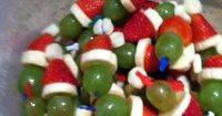 Simply layer mini marshmallow, strawberry, banana slice and grape on a small cocktail stick...Ta Da you have Grinch Kabobs!!