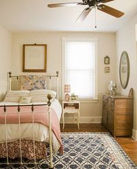 lovely guest room - I like the mix of prints with white bedding. Pink/red gingham blanket, flowery-like bed skirt (can make this easily), and blue accents. Little antique frames on wall with oval mirror. Could dress it up more with garden-themed p...