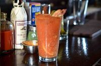Award winning Bloody Mary recipe - dash of celery salt, dash of white pepper, dash of tabasco, dash of Worcestershire sauce, 4 ounces of tomato juice, 2 ounces of vodka, 1/4 squeezed lemon, teaspoon of horseradish, few dashes of dried dill, half ounce of ...