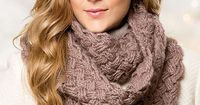 """Master the luxurious warmth of endless dimensional cables in this chic cowl project. This e-pattern was originally published in the Winter 2014 issue of Crochet! magazine. Size: 5 1/2"""" x 80"""" in circumference. Made with medium (worsted) w..."""