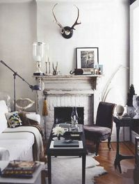 I think I've pinned this before but saw it again and love everything about it. The #vignette on the mantle, the mounted horns, skin rug, velvet chair, fireplace, ostrich egg, vintage phone. To die.