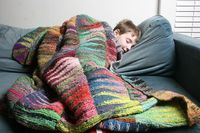 Cool knitted blanket - great way to use up small bits of yarn. Yes, beautiful!