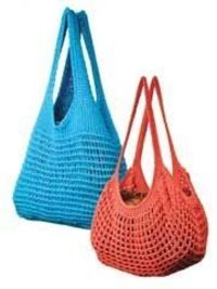 Crochet bags are as fun to use as they are to make! This Easy Tunisian Market Bags Crochet Pattern includes 2 lacy Tunisian cotton bag patterns: Blue Classic Market Bag and Tangerine French Market Bag. Great for travel!.