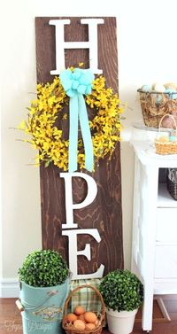 A stunning Hope Easter Wreath sign to add to your Easter decor. Stain a piece of plywood and add letters to spell hope by using a wreath for an 'o'.