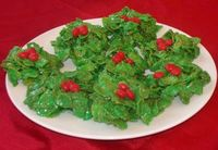 Holly treats - - cornflakes instead of rice crispies. . add green food coloring and top with red hots