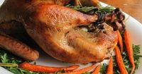 The biggest myth in all of American cookery is the belief that a juicy, perfectly cooked turkey is difficult for the novice cook to achieve. One of the secrets to a moist, delicious, and beautiful turkey is spreading butter under the skin. You can season ...
