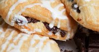 These vanilla drizzled candy bar croissants are quick to make and quick to disappear.. Vanilla Drizzled Candy Bar Croissants Recipe from Grandmothers Kitchen.